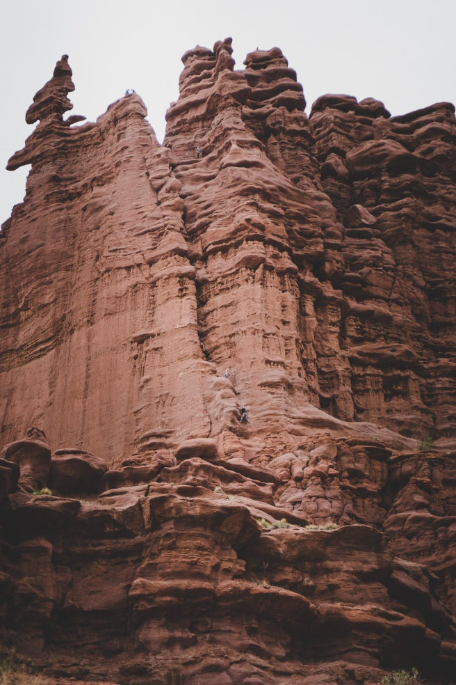 5 climbers on the rock face at Fisher Towers.
